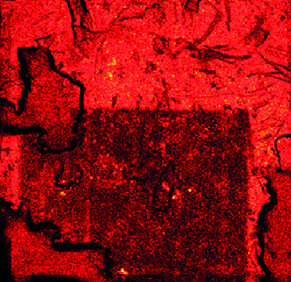 Figure 3 (Top Right): Image of a 7 × 7 mm graphene sheet with polymer residue after a region has been targeted by argon gas cluster 'sputtering'. The lighter red areas show greater polymer present, with an obvious reduction in polymer in the region targeted in the lower half of the image.