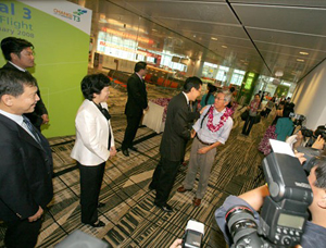 Raymond Lim greets arriving passengers at Changi T3